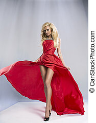 Beauty blond woman in red dress