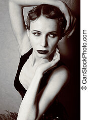 beauty blond woman in studio black and white, old-fashioned...
