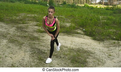 beauty blonde in sports uniform practicing outdoors