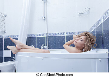 Beauty blonde woman relax in bath