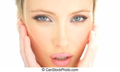 beauty blonde woman touching her fresh face showing her skin