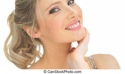 beauty blonde woman touching her face