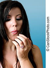 Beauty - blowing on painted fingernails - A girl blowing...