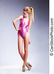 Beauty body of sexy woman in pink lingerie, studio shot