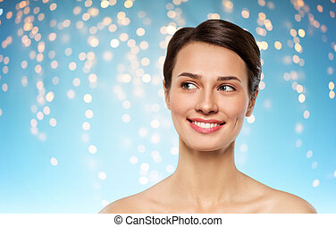 beautiful smiling young woman with bare shoulder