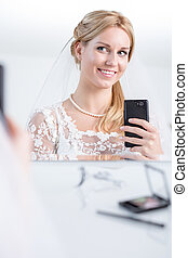 Beauty bride taking photo of herself