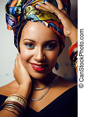 beauty bright african woman with creative make up, shawl on head like cubian