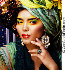 beauty bright woman with creative make up, many shawls on head like cubian, ethno
