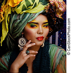beauty bright woman with creative make up, many shawls on ...