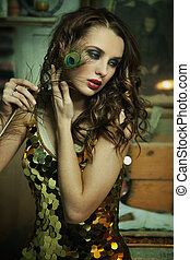 Beauty brunette in gold dress