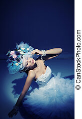 Beauty brunette in white dress