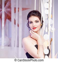 Beauty Brunette model woman holiday make up. Elegant girl in...
