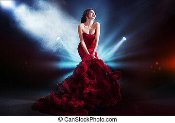 Beauty Brunette model woman in  evening red dress