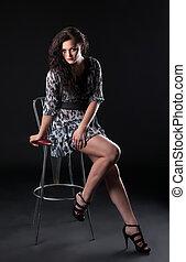 Beauty brunette sit on bar chair