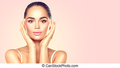 Beauty brunette spa woman touching her face. Skincare concept
