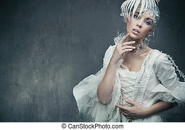 Beauty brunette wearing fashionable dress