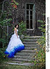 Beauty brunette wearing wedding dress