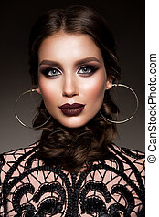 Beauty Brunette Woman with Perfect Makeup. Beautiful Professional Holiday Make-up.