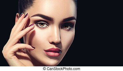 Beauty brunette woman with perfect makeup isolated on black...