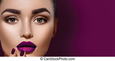 Beauty brunette woman with professional holiday makeup