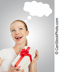 beauty cheerful girl with a Christmas gift