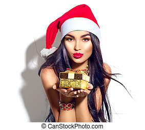 Beauty Christmas fashion model girl holding golden gift box
