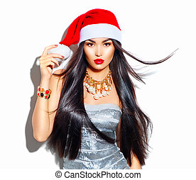 Beauty Christmas fashion model girl with long straight flying hair in red santa hat