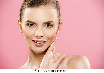Beauty Concept - Beautiful Woman with Clean Fresh Skin close up on pink studio. Skin care face. Cosmetology.