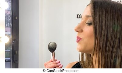Beauty concept. Beauty model girl applying paint with brush