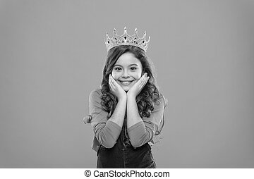 Beauty contest model. Kid wear golden crown symbol of princess. Childhood concept. Every girl dreaming to become princess. Lady little princess. Girl cute baby wear crown while stand blue background