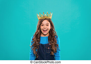 Beauty contest model. Kid wear golden crown symbol of princess. Every girl dreaming to become princess. Lady little princess. Girl cute baby wear crown while stand blue background. Childhood concept