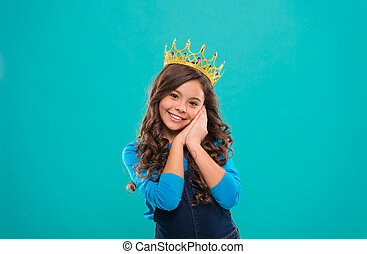 Beauty contest model. Kid wear golden crown symbol of princess. Girl cute baby wear crown while stand blue background. Childhood concept. Every girl dreaming to become princess. Lady little princess