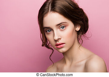 Beauty cute fashion model with natural make up on pink...