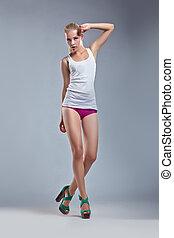 Beauty erotic woman blonde, sexy body posing in singlet