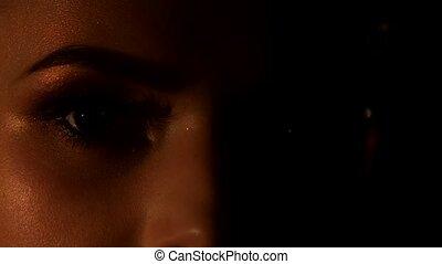 Natural makeup, beautiful model showing her professional makeup, beautiful model showing her professional makeup, on black background, closeup