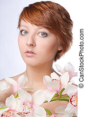 Beauty face of the young woman with flower