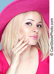 Beauty fashion blond woman in pink hat with makeup and manicured nails. Bob hairstyle.