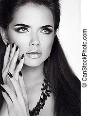 Beauty Fashion Brunette Woman Portrait. Trendy Fashion Jewelry. Black and white studio photo