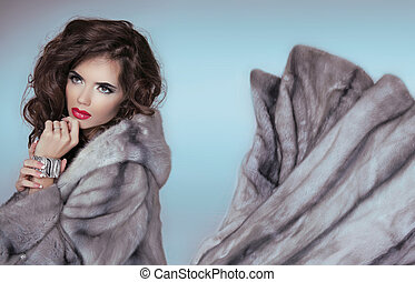 Beauty Fashion Model Girl in Blue Mink Fur Coat. Beautiful Luxury