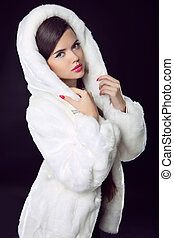 Beauty Fashion Model Girl in Mink Fur Coat and white furry...