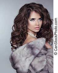 Beauty Fashion Model Girl in Mink Fur Coat. Beautiful Luxury Winter Woman isolated on gray background