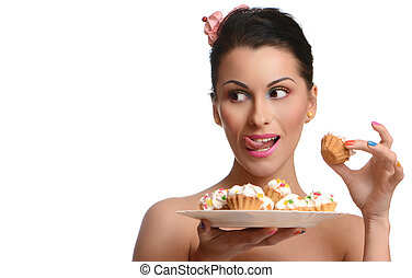 Beauty fashion model girl taking colorful cakes