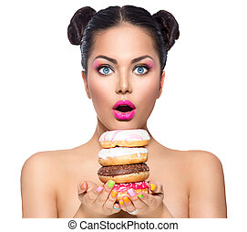 Beauty fashion model girl taking stack of colorful donuts