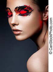 Beauty fashion model girl with dark bright orange make-up. Close up portret.