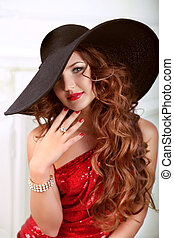 Beauty Fashion Model Lady with long red wavy hair styling, weari