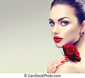 Beauty fashion model woman face. Portrait with red rose ...