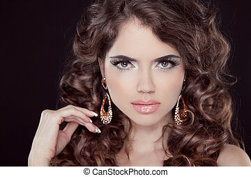 Beauty Fashion Model Woman touching her Long and Healthy Brown Hair. Beauty Brunette Girl isolated on black background.