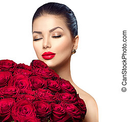 Beauty fashion model woman with big bouquet of red roses