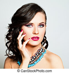 Beauty Fashion Portrait. Beautiful Woman with Makeup and Hairstyle. Curly Hair, Sexy Pink Lips, Colorful Nails, Eye Shadow