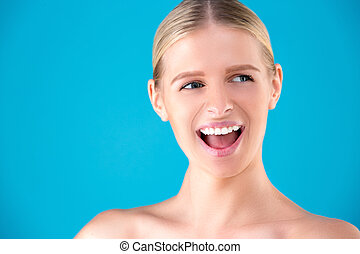 Beauty Fashion surprised Woman portrait. Beautiful model girl with perfect make up exited, screaming and open and mouth. Headshot. Emotions. Isolated on a blue background